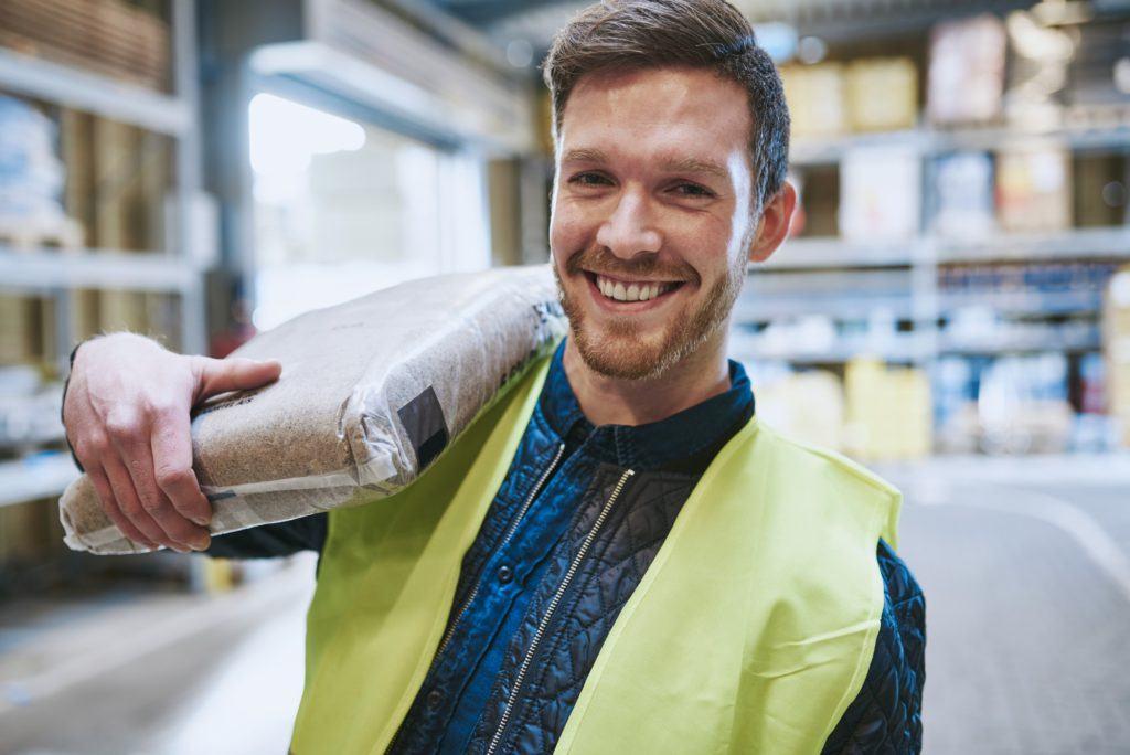 Friendly happy warehouse worker