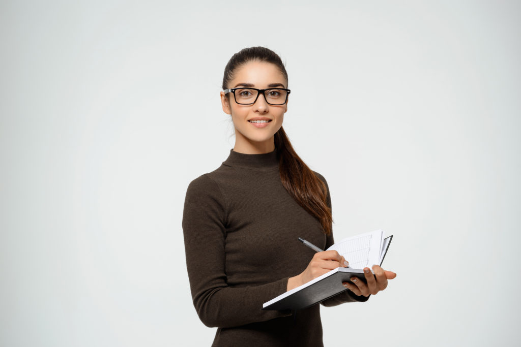 Confident smiling businesswoman writing notes 1