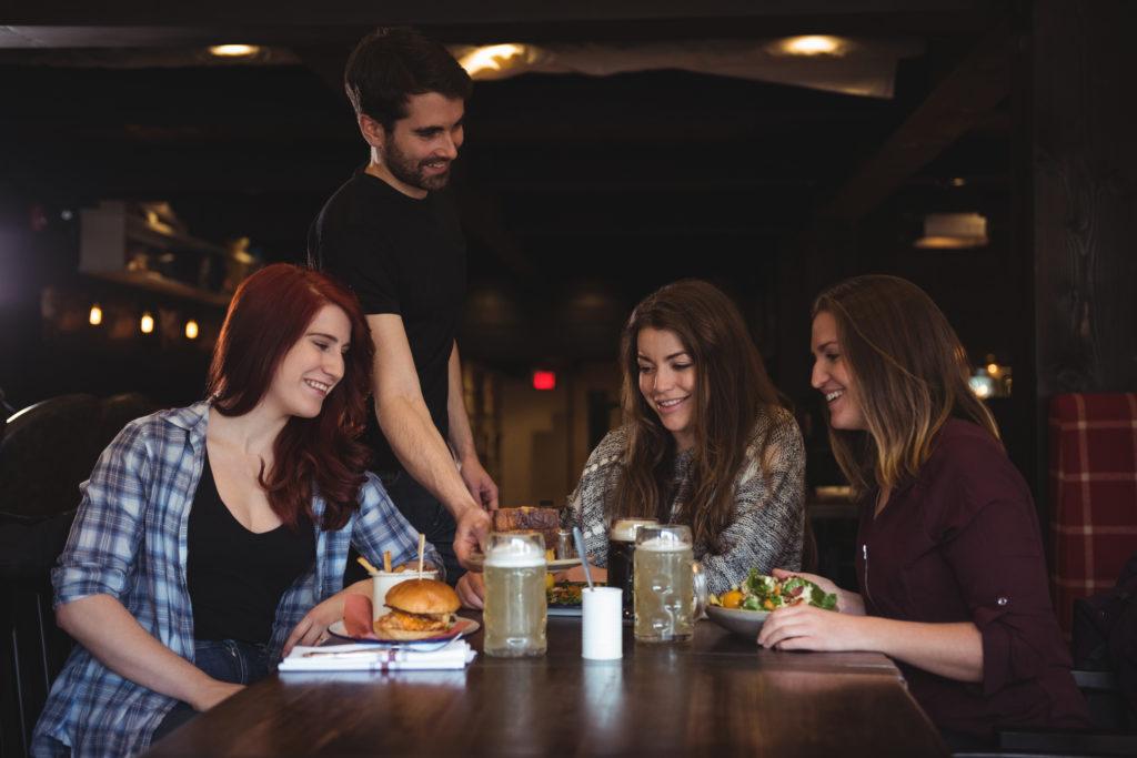 Friends having food in bar