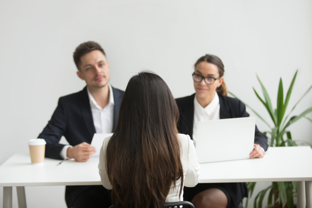 Headhunters interviewing female job candidate 2