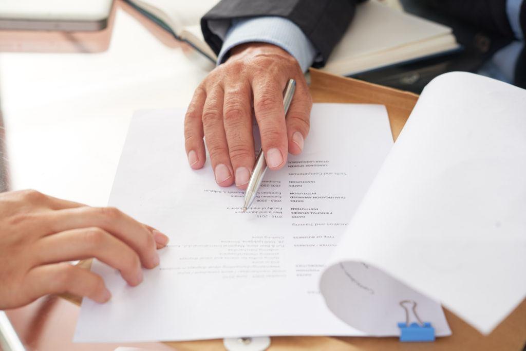 People examining business resume