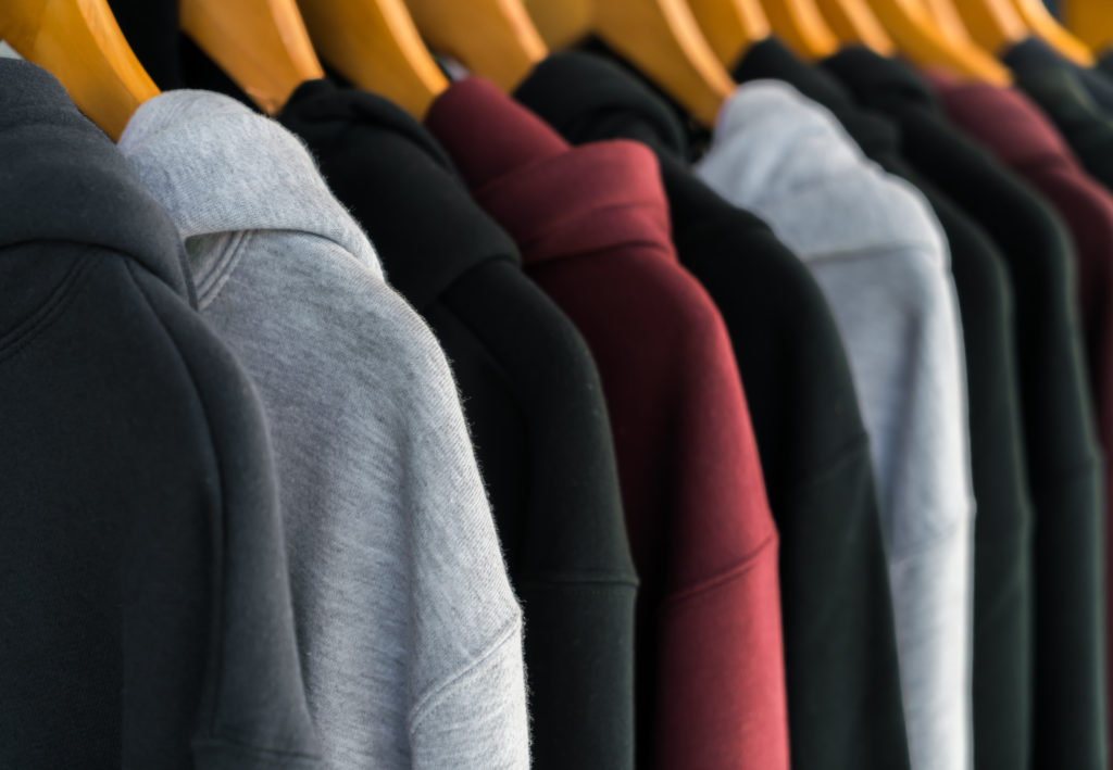 Row of fashionable clothing on hangers