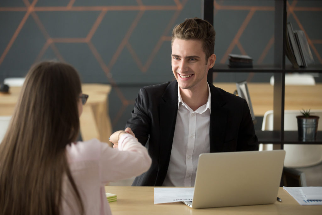 Smiling hr employer handshaking successful job applicant hiring or greeting 1